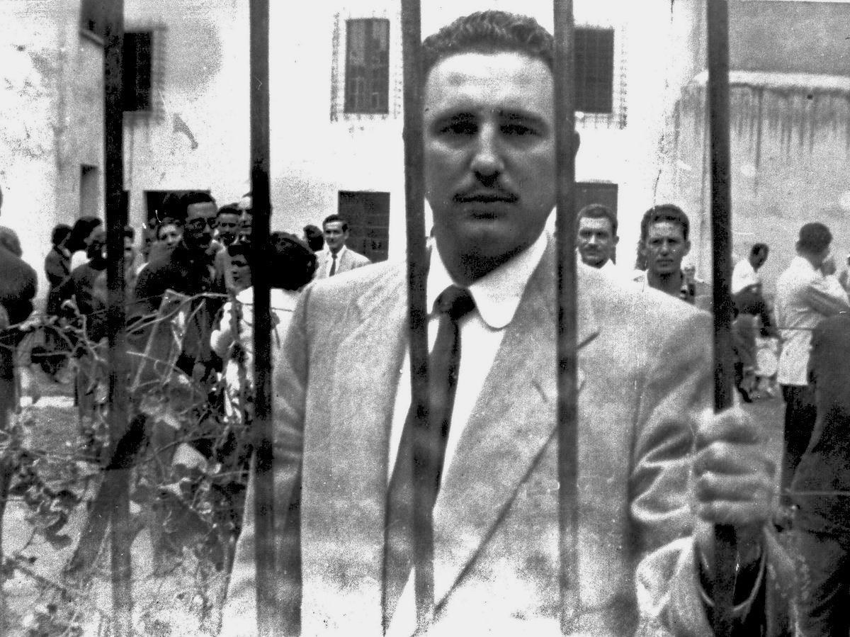 Castro behind bars.