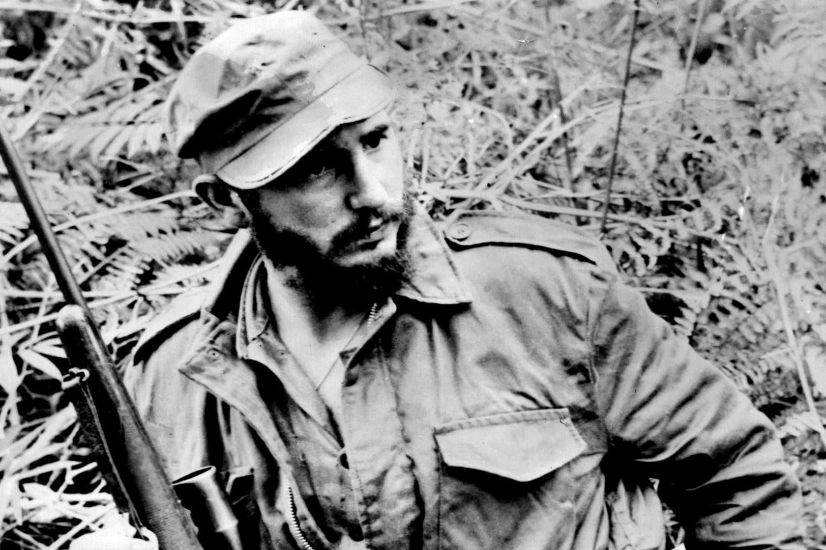 Castro posing with a Rifle.